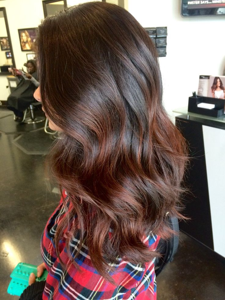 Low maintenance brunette hair with red balayaged highlights