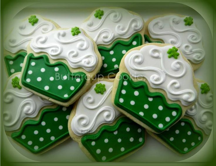 Cupcake decorated sugar cookies. Royal icing. Green, white. Polka dots, shamrock, St. Patrick's Day.