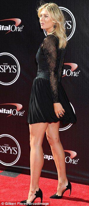 Fashion champion: Tennis star Maria Sharapova displayed her statuesque figure in a leg-bar...