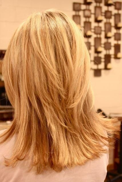 I see blunt ends with long layers through the crown area without being too scooped out