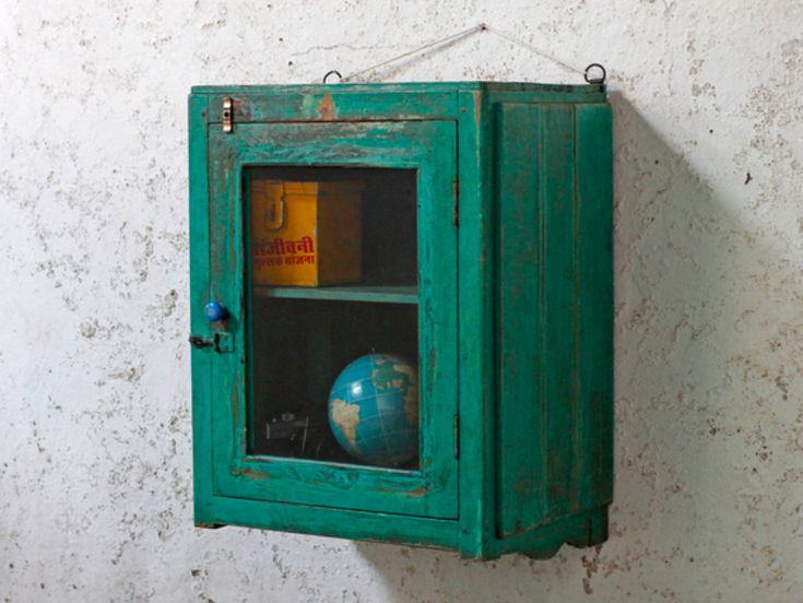 A gorgeously distressed green vintage wall-mounted display cabinet with a wonderful aesthetic. #vintage #furniture #vintagefurniture #shabbychic #sale #offer #furnituresale #cabinet #kitchencabinet