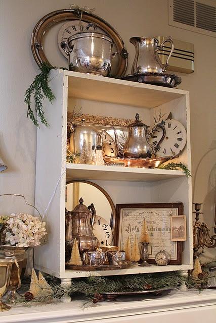 A cute little shelf with cute little things on it! Silver!