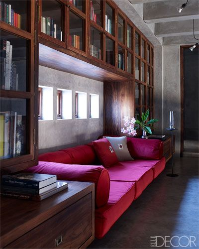 In the library, the sofa's upholstery and embroidered pillows are by Lesage.