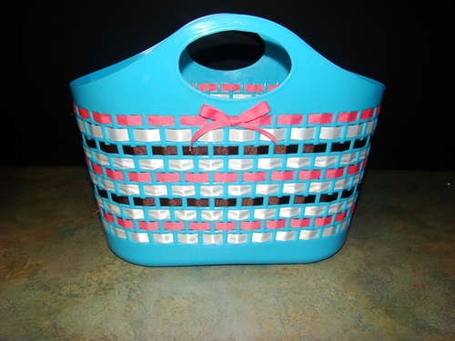 DIY - dress up a plastic basket with ribbon and/or cloth strips.