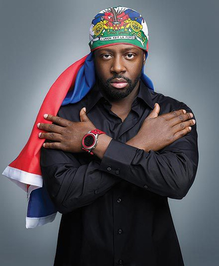 Wyclef Jean (wearing the Haitian flag), Haitian-American rapper, singer-songwriter, musician, record producer, and former member of the Fugees. His solo hits include We Trying to Stay Alive, Guantanamera, Gone till November, It Doesn't Matter (with The Rock), 911 (with Mary J. Blige), Yéle, and Two Wrongs (with Claudette Ortiz). After the Haiti earthquake, he filed for candidacy in the 2010 Haitian presidential election, but was denied since he hadn't live in Haiti the required 5 years.