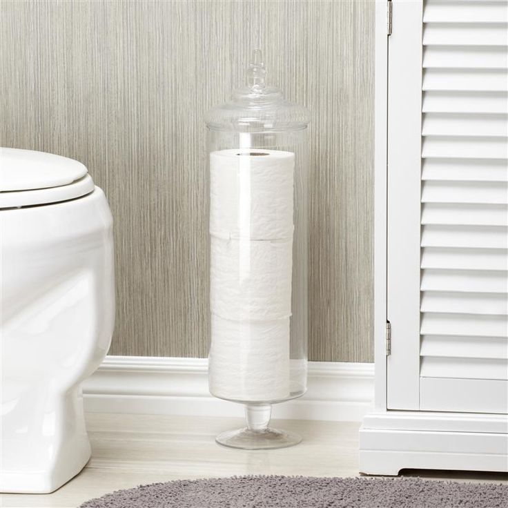 AQ apothecary jar used as a toilet paper holder.