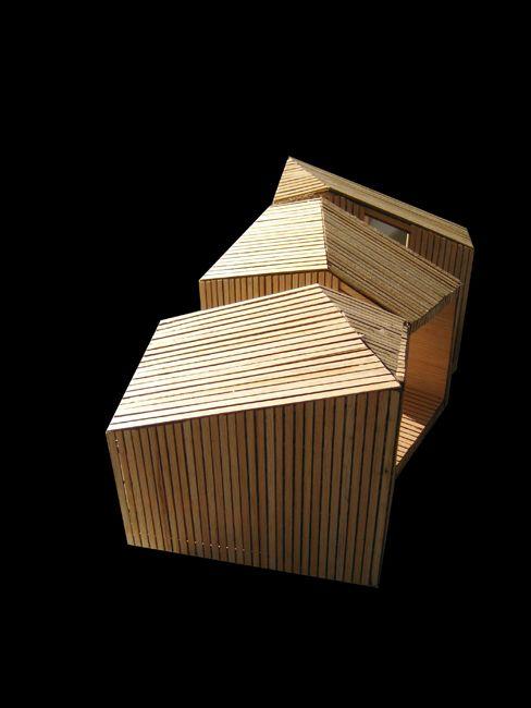 Hacer volumenes de triplay poner tiras de madera para darles textura