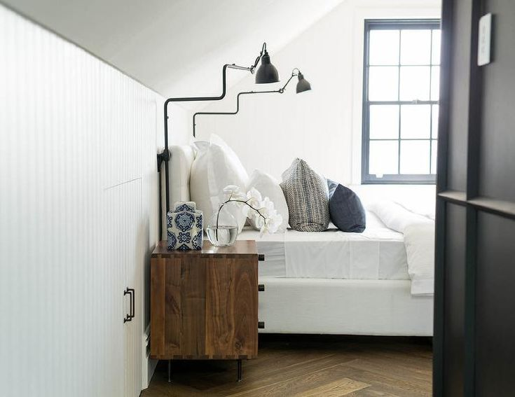 white tufted bed with vintage swing arm sconces bedroom