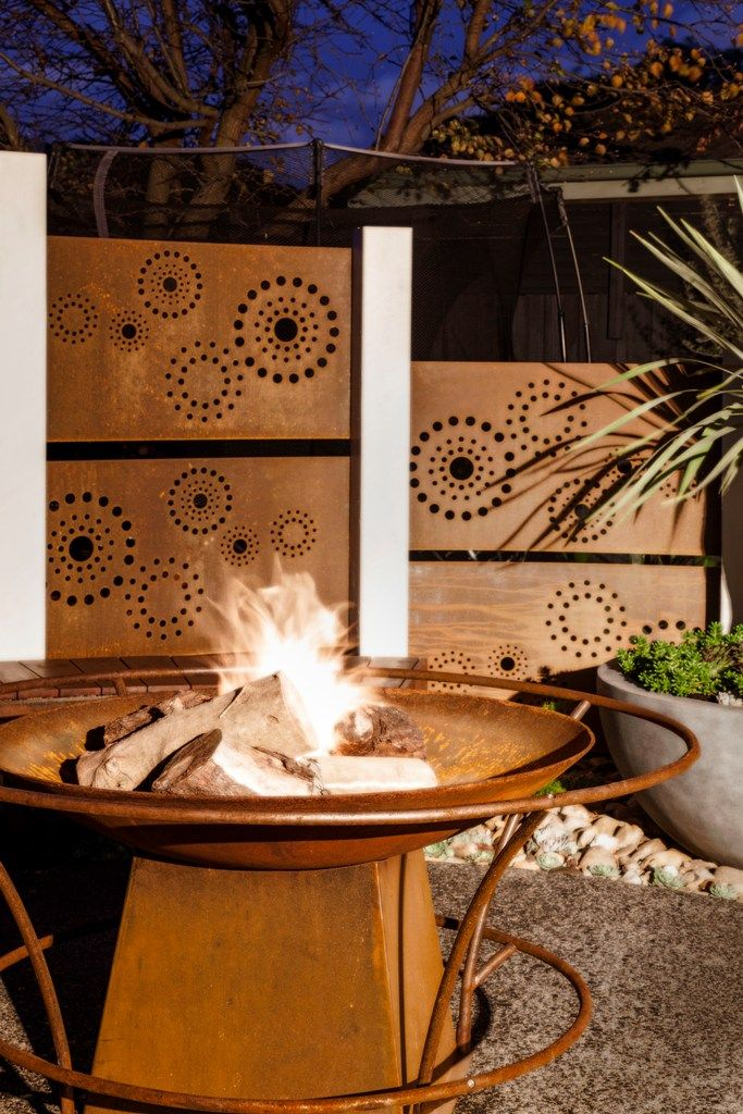 Laser cut metal art privacy partitions & fire pit by Entanglements. Fence topper designs.