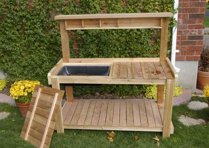 Hubby is going to build a new potting bench for me.  Thinking about this design with some drawers and a sink.