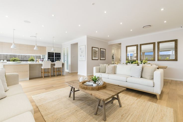 Relax and unwind in a living hub that offers everything you could possibly desire - indoor/outdoor living, plenty of space, a striking Gourmet Kitchen and lots of room to catch up with the family. This is the living hub from our Miami 16 on display in HomeWorld South, Gledswood Hills - http://mcdonaldjoneshomes.com.au/display-home-locations/homeworld-south-gledswood-hills. #kitchen #islandbench #livingroom #loungeroom #lounge #coffeetable #floorboards #ledlights #pendantlights #lights