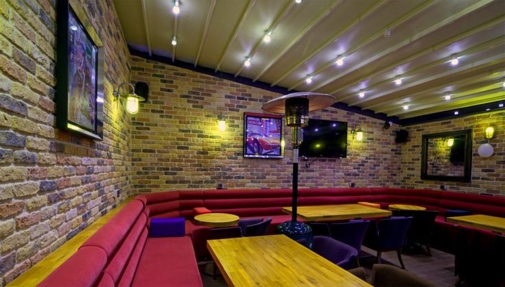 Bar with Sunset Blend Brick Slips and bright colourful furniture!