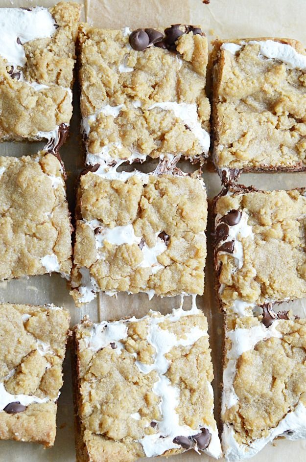 Soft, chewy, and slightly crunchy graham cracker cookie bars with a marshmallow swirl and semi-sweet chocolate chips. If I could only eat one dessert for the rest of my life… Well, I wouldn't be able to choose between a S'more and a Chocolate Chip Cookie. Honestly.So, in the event I'm ever cruelly and inhumanely forced …