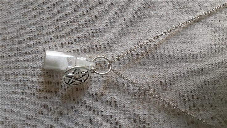 Supernatural inspired Necklaces.  Chose your combo, silver necklaces included. Salt and Blood Salt and Pentacle Salt and Angel Wings Salt and Tiny Wing Castiels Grace and Tiny Wing  The tiny bottles are made from glass.
