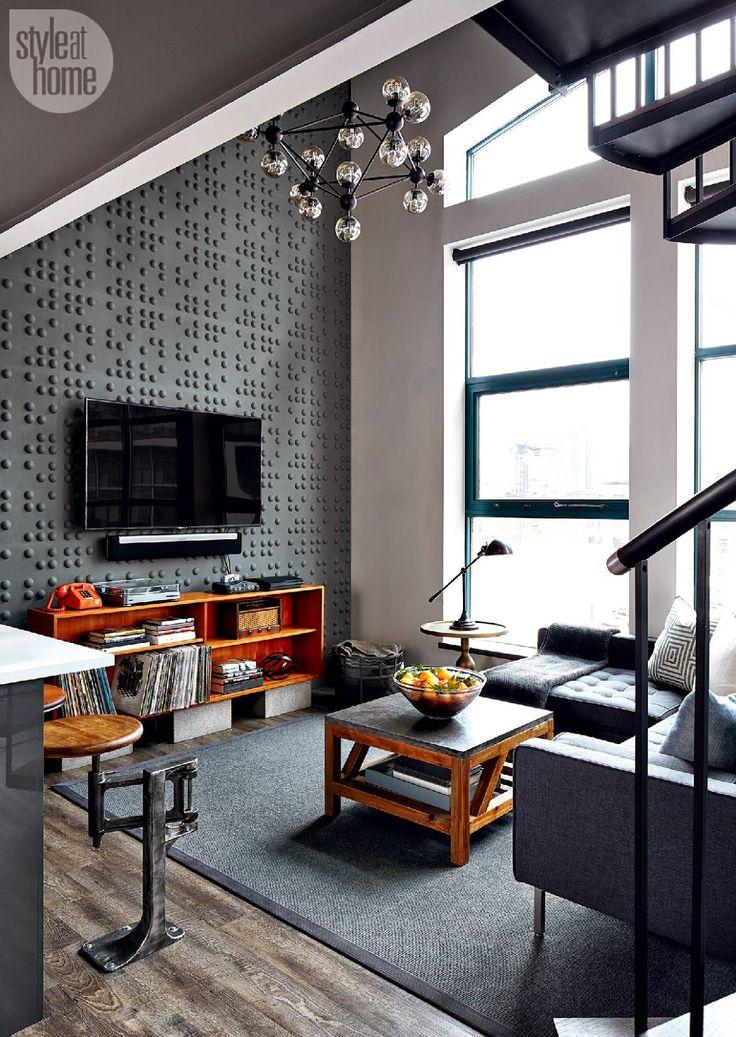 Accente retro-industriale și tonuri închise de culoare într-o amenajare de invidiat a unui loft de 70 m² din Toronto.