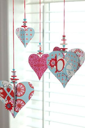Pretty paper & beaded heart ornaments dress up a window for Valentine's