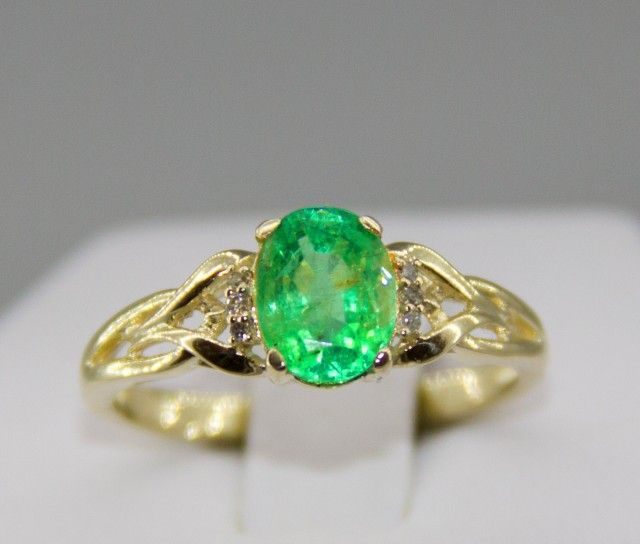 Gold ring with emerald 1.71 ct. and diamonds  EMERALD AND DIAMONDS  GEMSTONES IN RING SET FROM JEWELLERYAUCTIONED.COM
