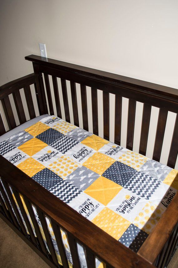 Happy patchwork baby crib or toddler quilt
