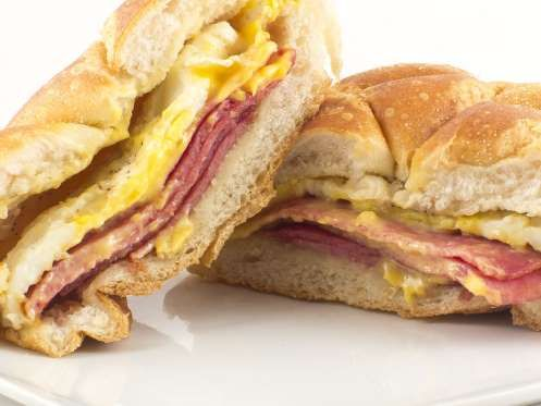 Slide 29 of 50: NEW JERSEY: Stop by any Garden State diner and try the signature Jersey breakfast sandwich. It's thick-cut Taylor ham (or pork roll) with egg and American cheese on a hard Kaiser roll or bagel.