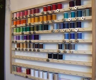 Wow....sewing threads and a matching bobbin in front of each colour, ready to use!!!! I don't do a heck of a lot of sewing, but this would be awesome for those who do!!!