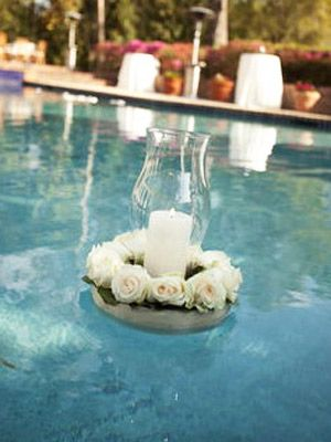 Floating Florals    If your venue has a pool, floating decor is a must. Pillar candles surrounded by all-white flowers have a romantic look.