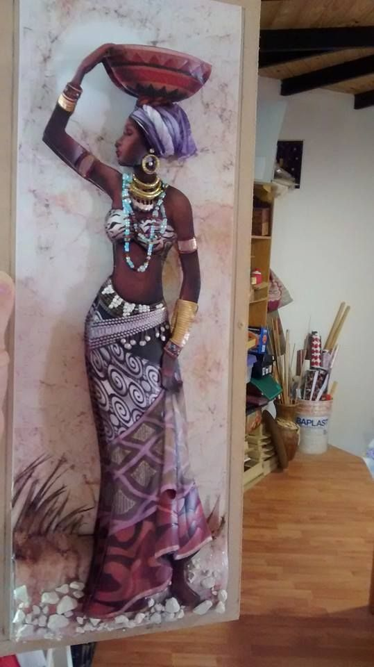 African Lady Carrying Bowl On Her Head.