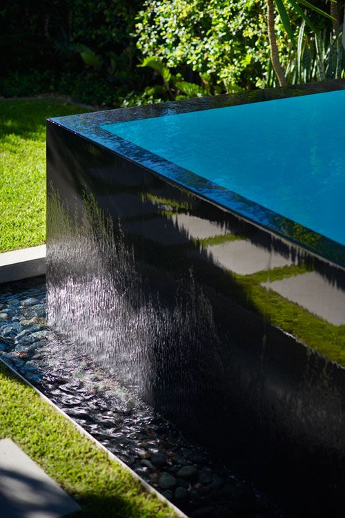 Black tiled pool infinity edge. Pinned to Pool Design by Darin Bradbury.