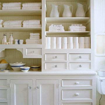 This crisp white bathroom hutch with crystal knobs looks fresh and organized. Plenty of shelves and drawers neatly store a plethora of towels and supplies