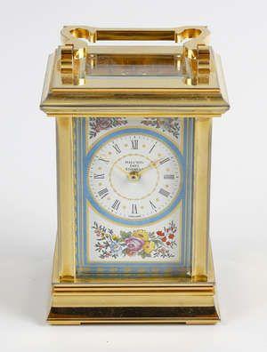 LOT:733 | A Halcyon Days enamel carriage clock.