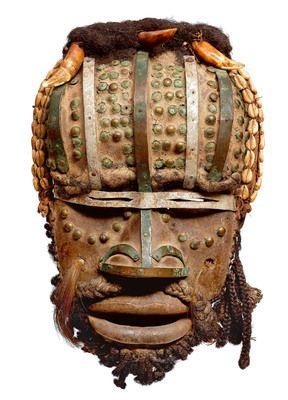 A Grebo mask   Wood, nails, cauries - 33 and 56 cm Liberia, Ivory Coast