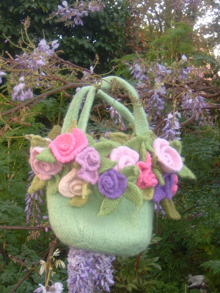 Hand knitted and fulled bag with hand knitted roses