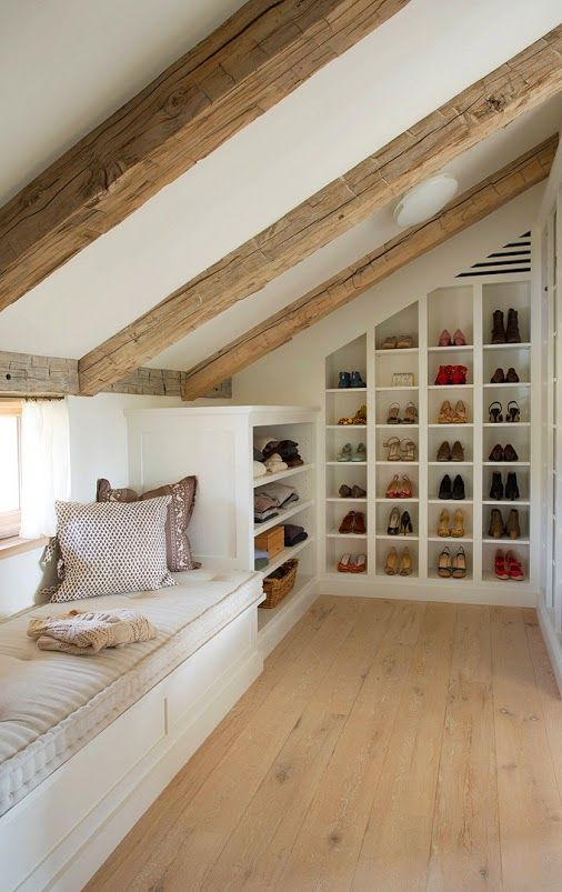 Attic closet, love the little sitting space
