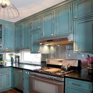 L Shape Teal Kitchen Cabinets Feat Black Countertop Grey Tile Backsplash In White Wall Ceiling  In Remarkable Furniture