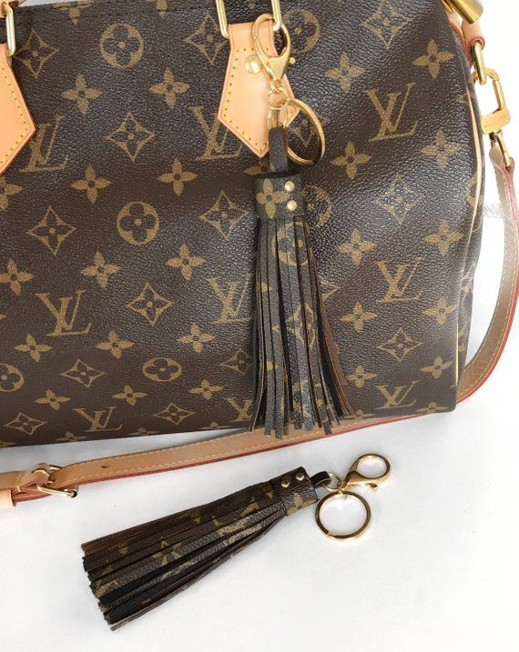Louis Vuitton Bag Charm Tassel This purse charm is made of authentic canvas  and black suede leather. The canvas is from a vintage Louis Vuitton piece. d894a5f4bbdce