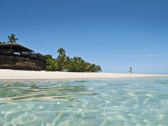Vomo Fijian Resort, A lone beach walker below The Rocks.