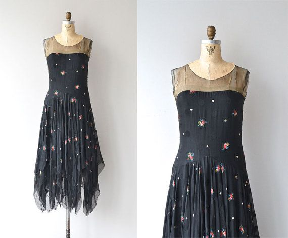 Vintage 1920s black silk dress with tonal black polka dots, embroidered flowers, sheer net upper bodice, airy silk chiffon layered skirt with handkerchief hem and metal side closures. --- M E A S U R E M E N T S ---  fits like: small bust: 32 waist: 27 & under hip: up to 38 length: 46 brand/maker: n/a condition: excellent  ✩ layaway is available for this item  to ensure a good fit, please read the sizing guide: http://www.etsy.com/shop/DearGolden/policy ...
