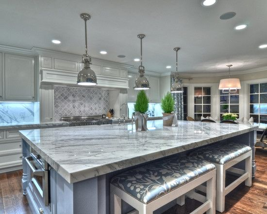 An Over Sized Kitchen Island With Bench Bar Stool Seating Granite And Marble Counter Tops