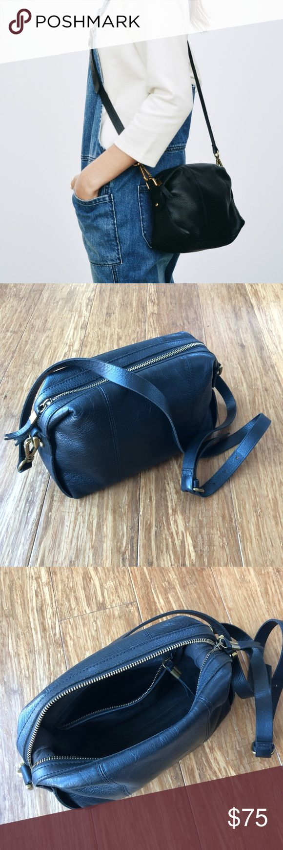 "Madewell Mini Glasgow Bag Black Madewell's go-anywhere bag in a new smaller size (that holds a surprising amount of stuff). Made of supersoft leather, this duffel-inspired design has a sturdy removable shoulder strap. Finished with Madewell's signature collar stud closures.  This item has been very gently pre-loved, please see photos. No large scratches, stains, etc. Minimal scratches and wear on corners shown in photos. * Leather * Zip closure. * Interior pocket. * 21 1/2"" shoulder strap…"