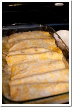 TO-DIE-FOR CREAM CHEESE CHICKEN ENCHILADAS 2-3 chicken breasts, shredded 1 8 oz. pkg. cream cheese 1 28 oz. can green enchilada sauce 1 can black beans, drained rinsed 2 cups cooked rice Tortillas 1-2 cups shredded monterrey colby cheese Cook chicken and shred; boil rice. Mix the shredded chicken, cream cheese, and 2 cups of the enchilada sauce together.