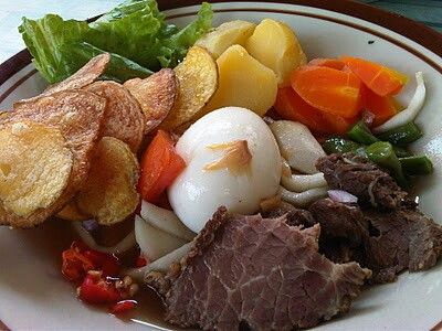 Selat Solo. This in a local intepretation of Dutch steak. The beef is cooked in sweet soy sauce instead of fried and served with brown sauce/gravy.