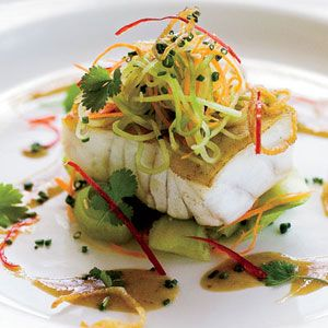 A simple salad of julienned cucumbers and carrots tossed with a soy-mustard dressing makes this light fish dish incredibly vibrant.