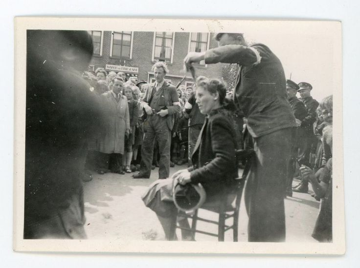 Vintage photo. WW2 soldier giving Forced haircut to Female Collaborator.
