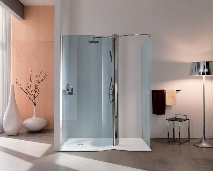 Nice shower design...semi-enclosed, no door or curtain, lots of room, lots of light