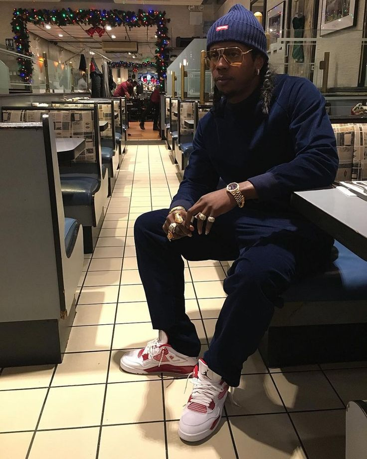 Trinidad James wearing the 'Alternate '89' Air Jordan 4