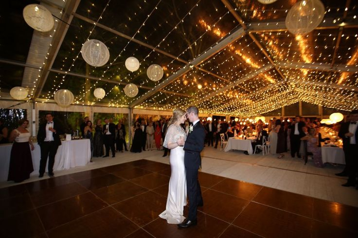 Excel Hire - Marquee, Flooring, Tables and Chairs etc Lighting by Avideas.