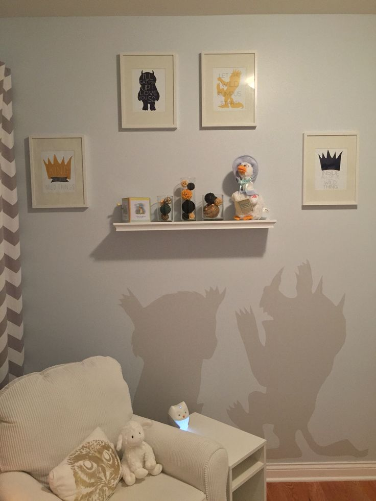 Our modern take on where the wild things are!! prints from Amazon, chair from babies r us, shelf from target, and curtains from pottery barn kids