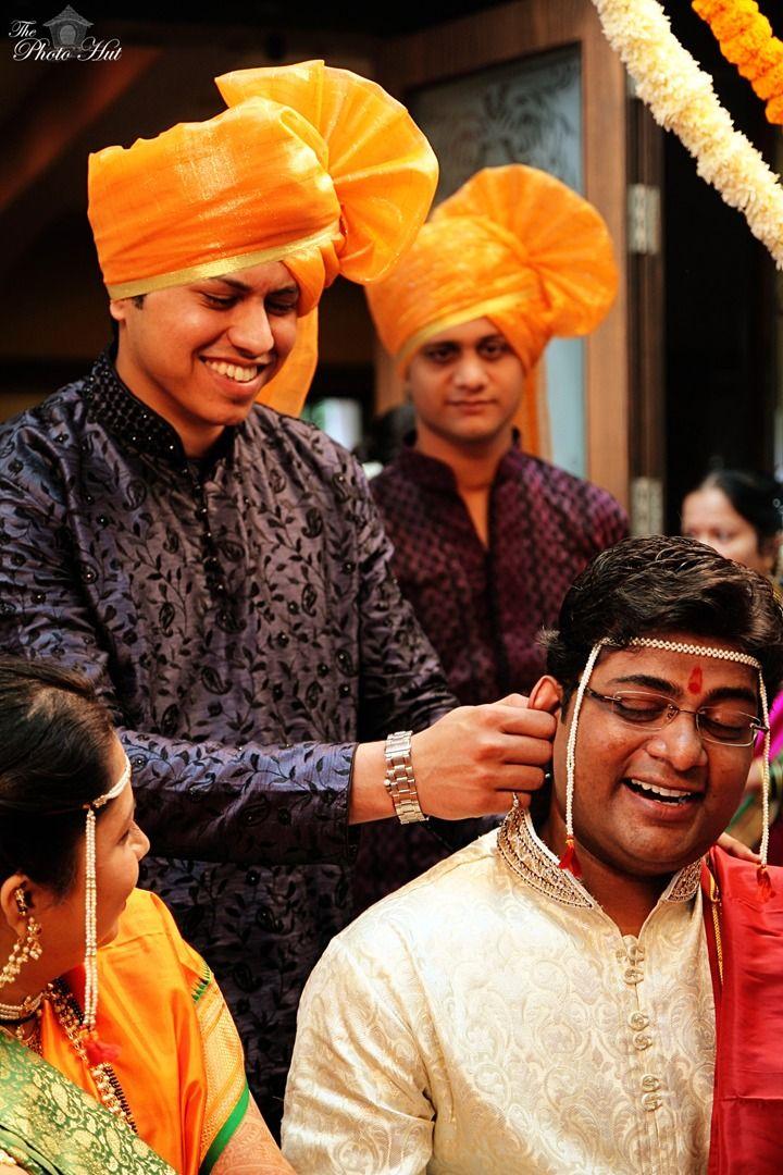 Ear Twisitng Ritual - Weddings | Indian Wedding Photography, Pune