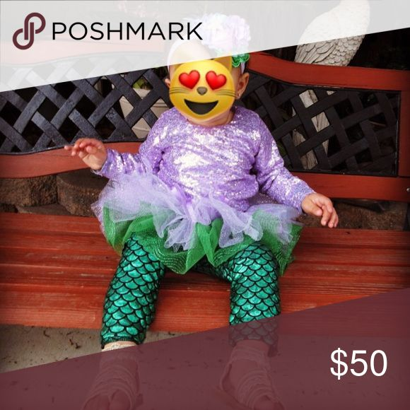 Babys first birthday mermaid outfit Babys first birthday outfit for sale. Mermaid theme. Purple lavender and green. Comes with every peice of the outfit.                                  The shirt is full lavender sequence (12-18mo) mermaid leggings (24mo) (leggings run a little small). Homemade tutu. And the purple under the sea themed headband with rosettes and a starfish.                                                              Can be purchased separately (i spent almost 100 on the…