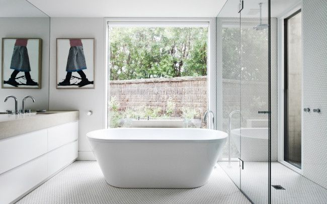 Floor to wall hexagon mosaics in this white bathroom for Residential interior design ideas