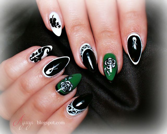 Black & white nails with a green accent, nail design